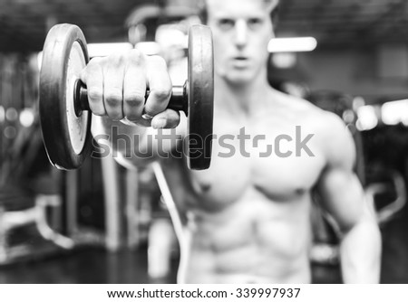 Black and white concept about gym. Athlete lifting weights - stock photo