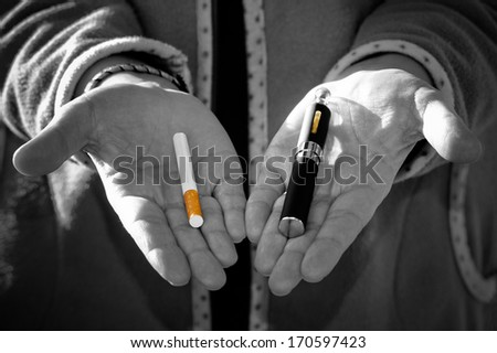 Black and white desaturated which has the concept of choosing the type of cigarette - stock photo