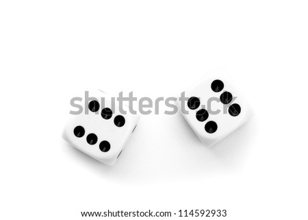 Black and white dices against a white background - stock photo