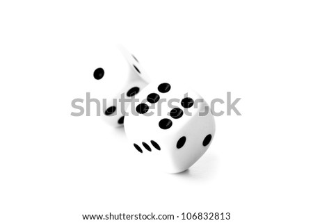 Black and white dices in motion against a white background - stock photo