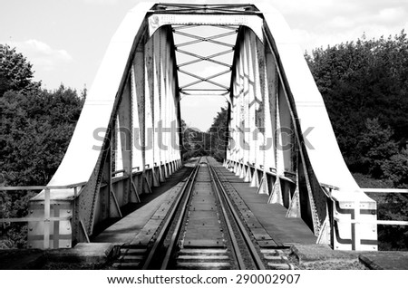 black and white effected old rusty railway bridge in Hungary - stock photo