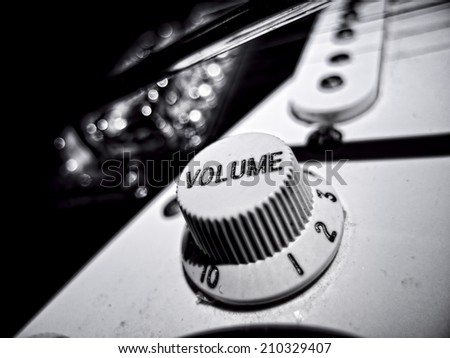 Black and White extreme close up of electric guitar volume knob - stock photo
