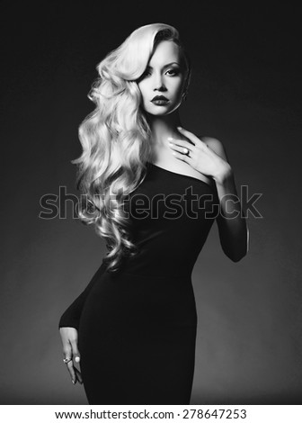 Black and white fashion art photo of elegant blonde on black background - stock photo