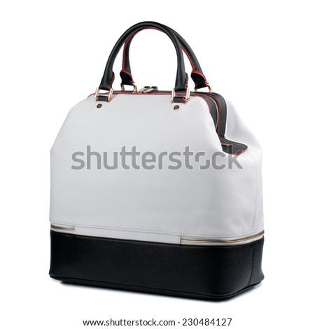 Black and white  female handbag isolated on white background. - stock photo
