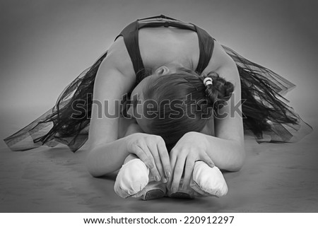 Black and white foto of young stretching ballerina - stock photo
