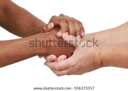 Black and white hands in a friendly hand shake - stock photo