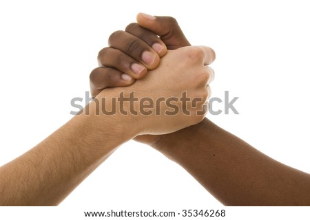 Black and white hands shaking in friendly agreement isolated on white - stock photo