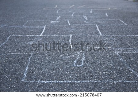 Black and white hopscotch one through nine at a playground - stock photo