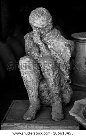 Black and white human victim body cast from Pompeii - stock photo