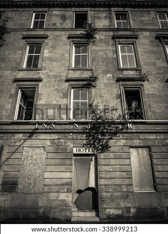 Black And White Image Of A Derelict And Boarded Up Hotel - stock photo