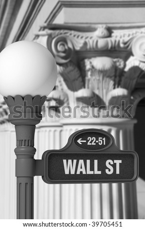 Black and white image of a Wall Street sign post in front of rows of Corinthian columns - stock photo