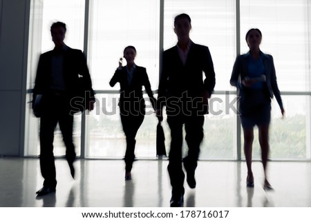 Black and white image of businesspeople in rush  - stock photo