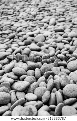 Black and white image of granite pebbles using a narrow depth of field composition - stock photo