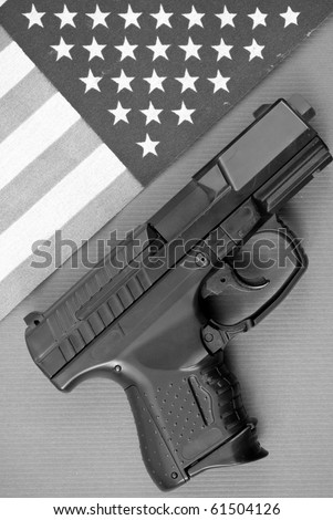 Black and White Image of Gun and Flag - stock photo