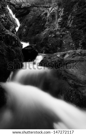 Black and white image of Lower Dark Hollow Falls, in Shenandoah National Park, Virginia. - stock photo