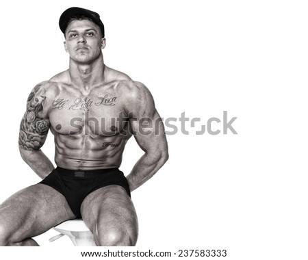 Black and white image of pumped man - stock photo