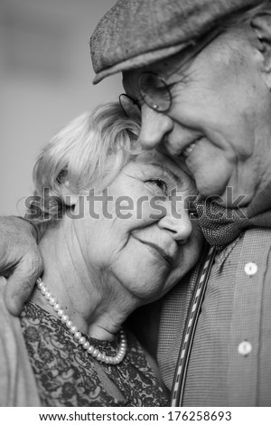 Black-and-white image of senior couple in smart clothes - stock photo