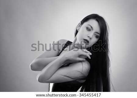 black and white image of sex woman wearing latex - stock photo