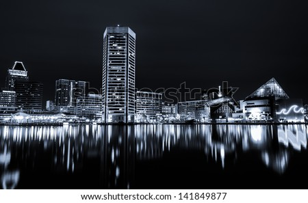 Black and white image of the Baltimore Inner Harbor Skyline at night - stock photo