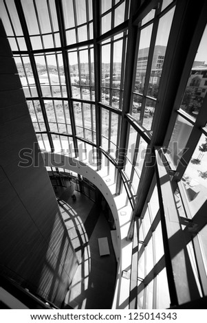 Black and white image of windows in modern office building - stock photo