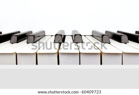 Black and white keys of a vintage white piano - stock photo