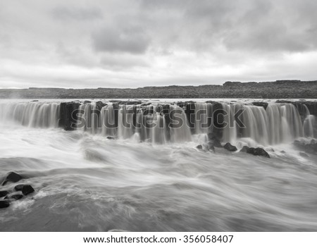 Black and white long exposure image of Selfoss waterfall on Jokulsa a Fjollum river in Iceland - stock photo