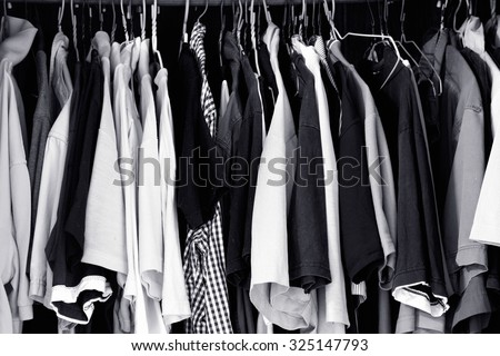 Black and White lot of t-shirt on a hanger / T-shirt on a hanger - stock photo