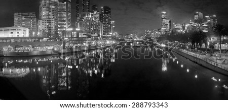 black and white melbourne city reflected in the yarra river at night and white melbourne city reflected in the yarra river at night - stock photo