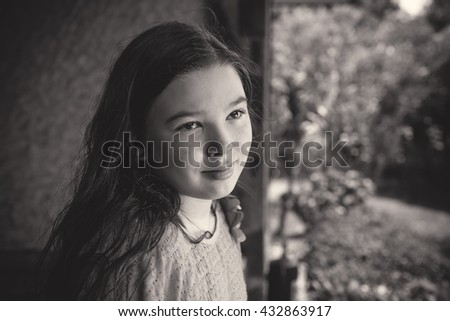 Black and white (monochrome) portrait of a pensive teen girl - stock photo