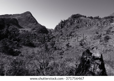 Black and white mountain with clear sky - stock photo