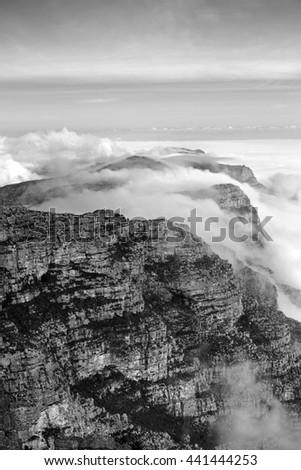 Black and white mountainous landscape - stock photo