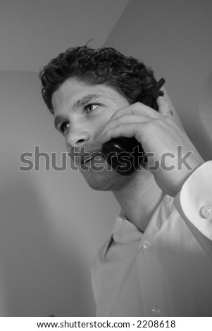Black and white of man on the phone.  More with this model. - stock photo