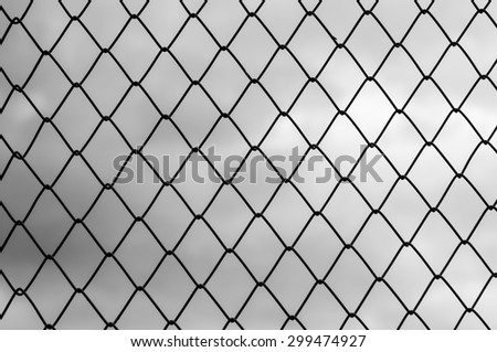 black and white of Metal wire fence or cage on abstract blurry background - stock photo