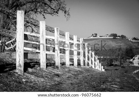 Black and White of White Aged Old Fence Along Trail in Paso Robles - stock photo