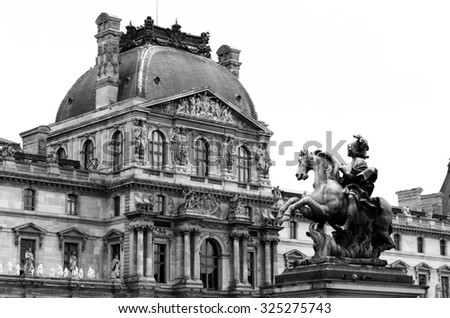 Black and white ofStatue of Louis xiv in louvre museum Paris France - stock photo