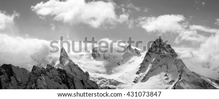 Black and white panorama mountains in cloud. Caucasus Mountains, region Dombay. - stock photo