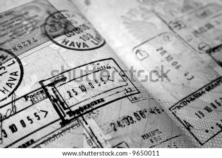 Black and white passport stamps - stock photo