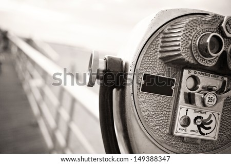 Black and white pay binoculars. Vintage high key travel concept - stock photo