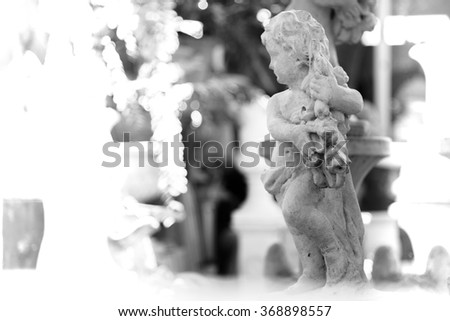 black and white photo effect of cupid statue background for valentine - stock photo