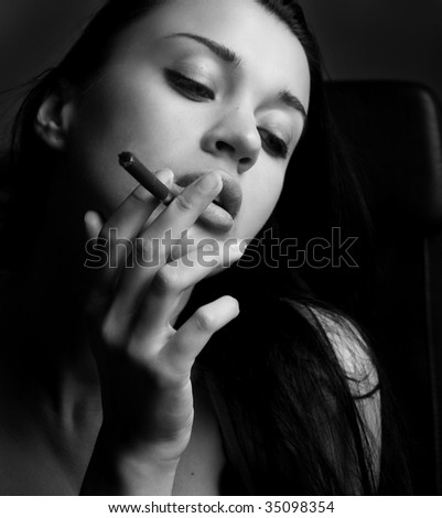 Black and white photo girl with cigarette - stock photo