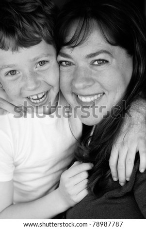 Black and white photo of a happy mother and son - stock photo