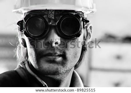 Black and white photo of a man in helmet and goggles - stock photo
