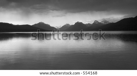 Black and white photo of a thunderstorm coming in over Lake McDonald, Glacier National Park, Montana - stock photo