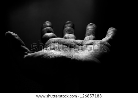 Black and white photo of an open hand - stock photo