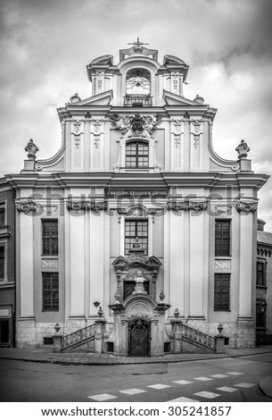 Black and white photo of antique St John church in old Cracow ( Krakow ), Poland - stock photo