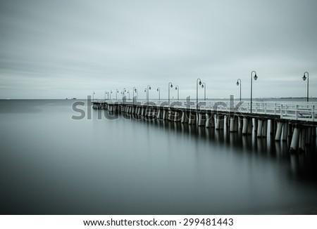 Black and white photo of Baltic sea shore seascape. Seascape Gdynia Orlowo - stock photo