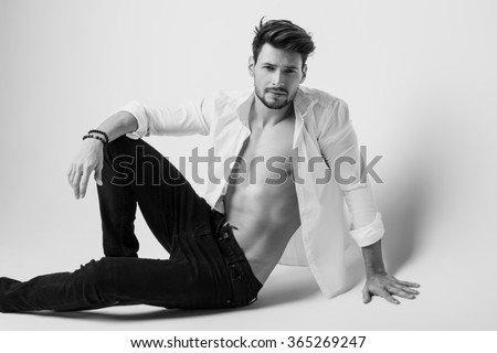 Black and white photo of handsome model - stock photo