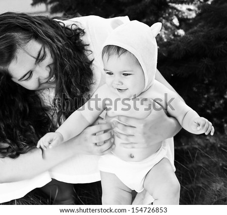 Black and white photo of mother and her baby - stock photo