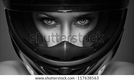 black and white photo of sexy woman in helmet on the background - stock photo