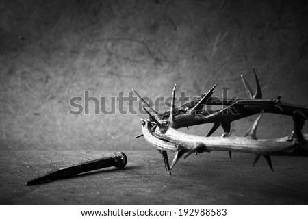Black and white photo. week of passion. Jesus Christ crown of thorns and a nail. - stock photo